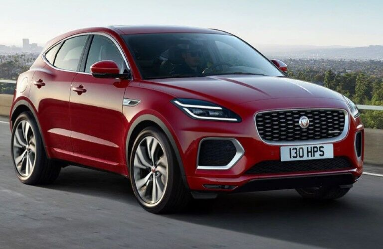 Red 2021 Jaguar E-PACE driving down street