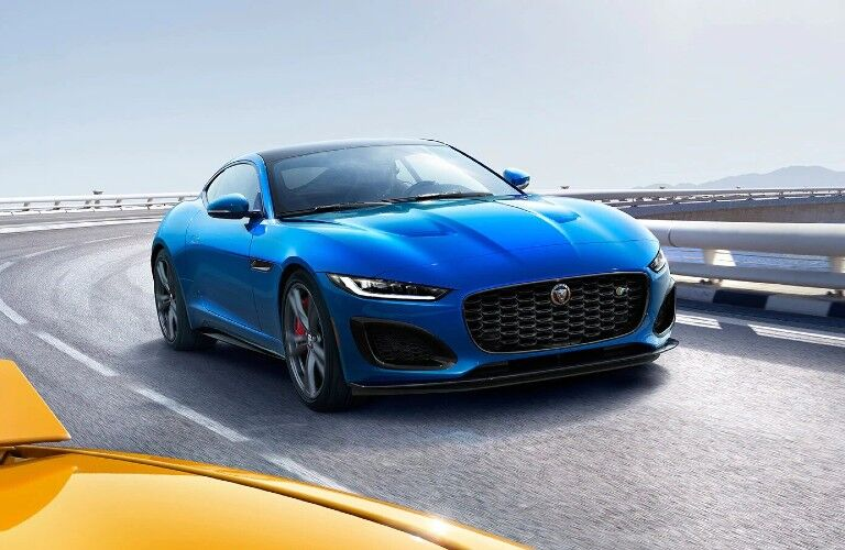 2021 jaguar f-type blue exterior front passenger side on race track