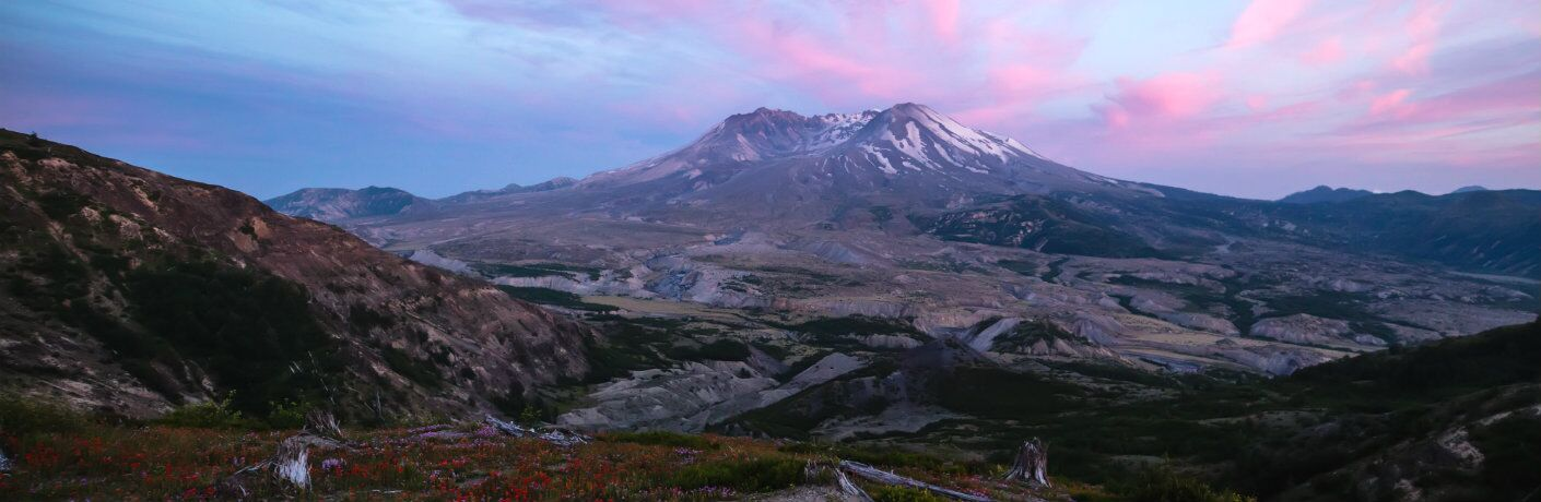 Mount Saint Helens with a pink, purple, and blue sky