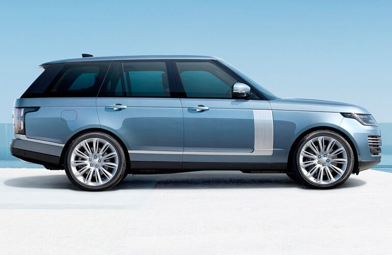 side profile of light blue Land Rover Range Rover with white detailing