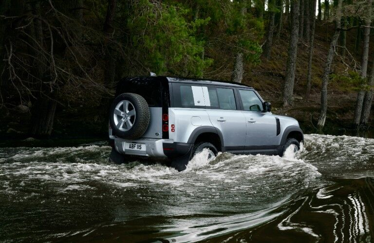 2020 Land Rover Defender driving through water
