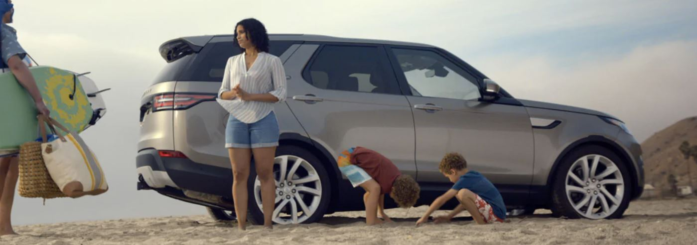 2020 Land Rover Discovery with a family at the beach