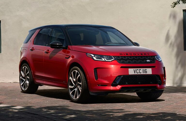 Passenger's side front angle view of red 2020 Land Rover Discovery Sport