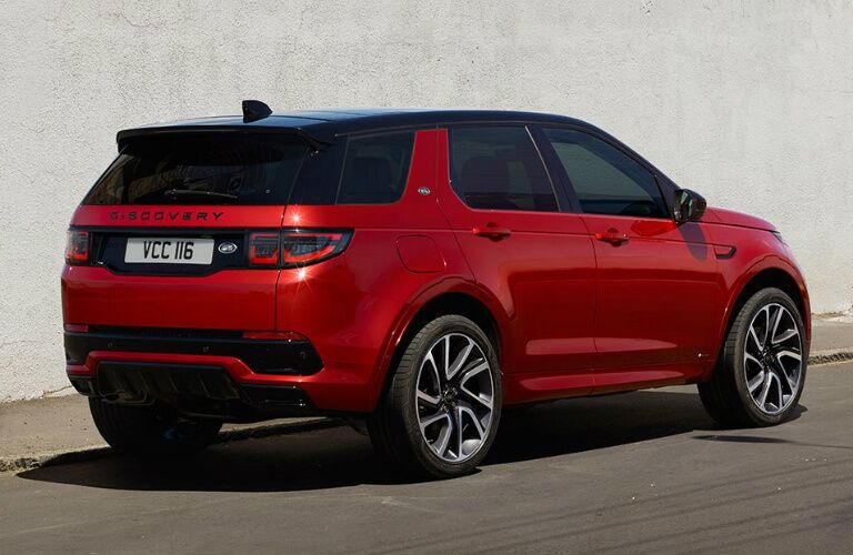 Passenger's side rear angle view of red 2020 Land Rover Discovery Sport