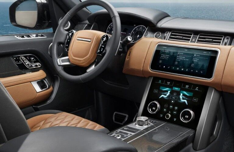 Steering wheel and center touchscreen interface inside 2020 Land Rover Range Rover