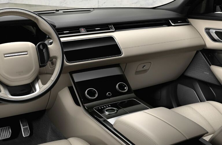 Dashboard and beige front seats in 2020 Land Rover Range Rover Velar
