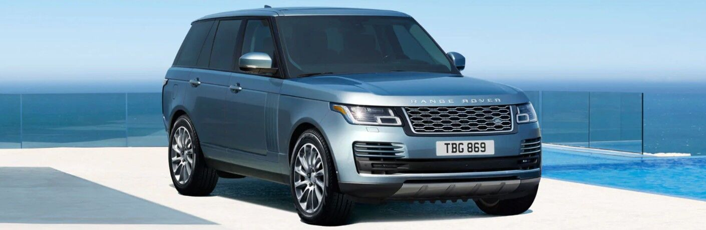 2020 Land Rover Range Rover parked on waterfront driveway