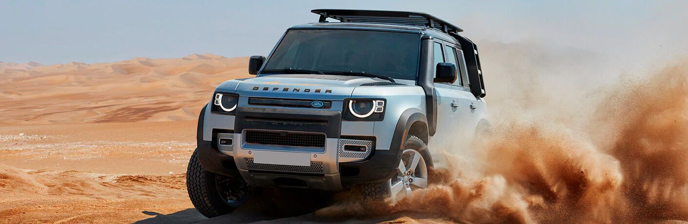 2021 Land Rover Defender front view in sand
