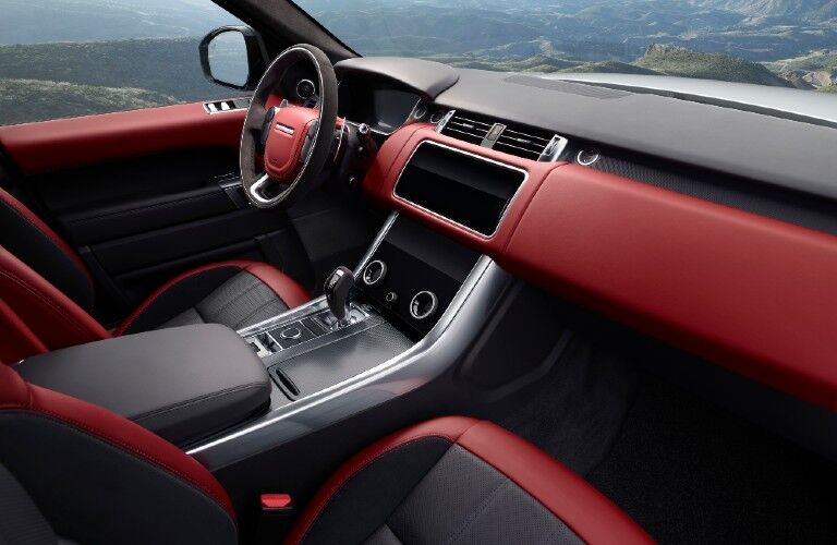 The front interior image of a 2021 Land Rover Range Rover Sport.