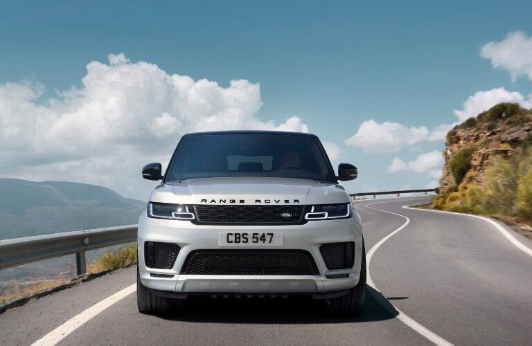 The front view of a light gray 2021 Land Rover Range Rover Sport.