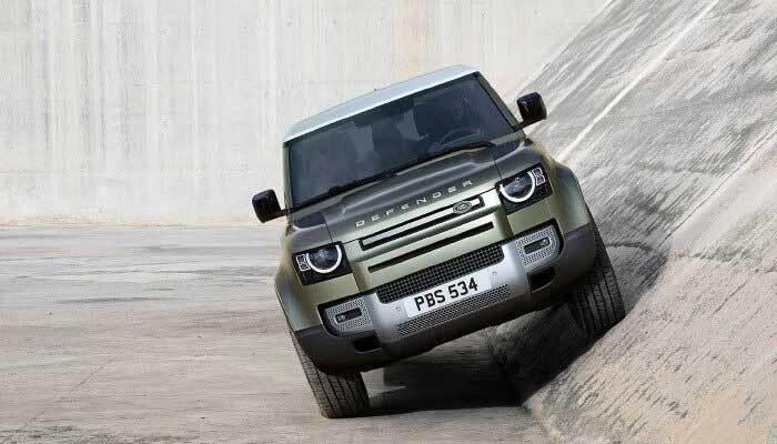 Land Rover Defender riding up an aqueduct