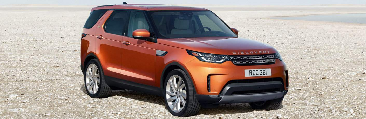 Orange 2018 Land Rover Discovery Parked in a Desert