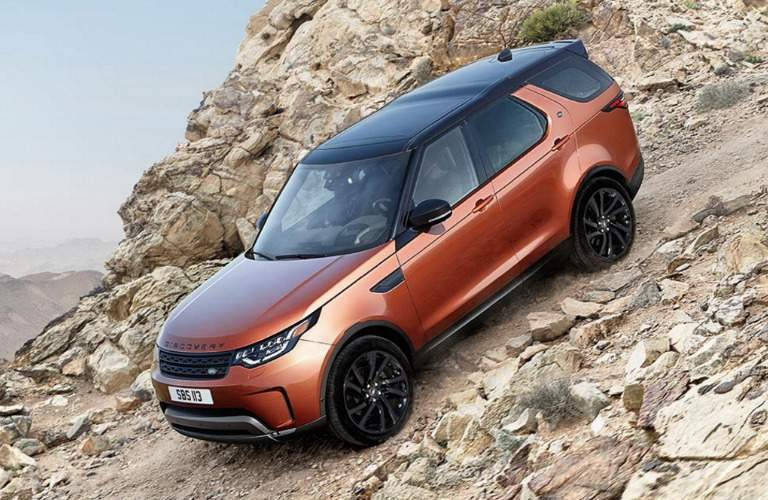 2018 land rover discovery driving down rocks