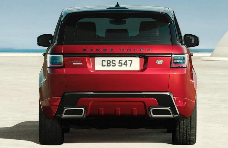 Rear View of Red 2018 Land Rover Range Rover Sport Parked by the Ocean