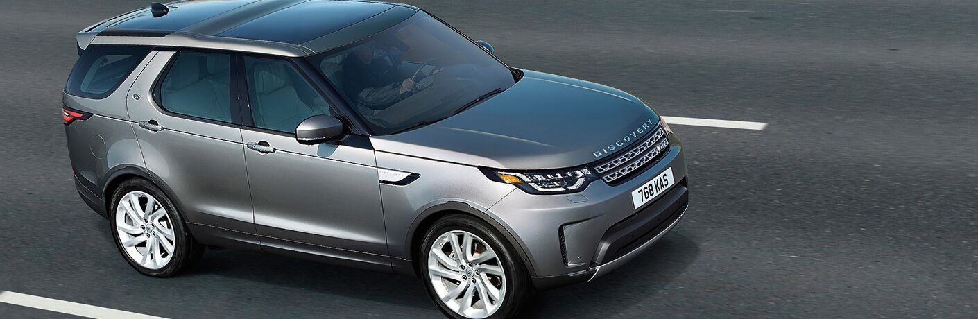 right side view of dark gray land rover discovery