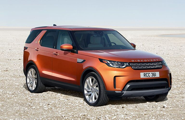 front, right side view of orange land rover discovery