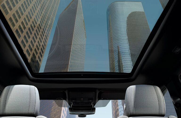 View of skyscrapers through the moonroof of a 2020 Land Rover Range Rover Evoque