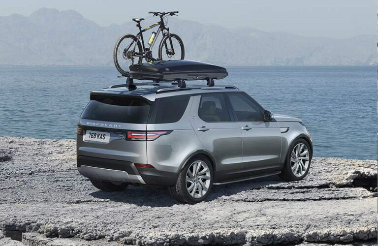 Silver 2020 Land Rover Discovery parked on a cliff next to the ocean