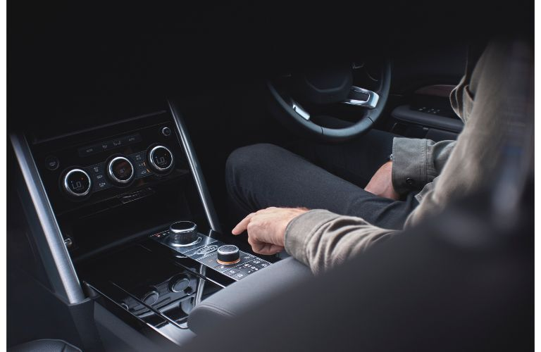 2020 Land Rover Discovery interior shot showing center console and knobs