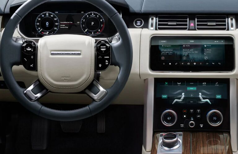 Steering wheel, gauges, infotainment system touchscreen, and climate control system in 2020 Land Rover Range Rover