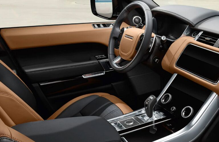 Light brown and dark grey dashboard and front seats in 2020 Land Rover Range Rover Sport