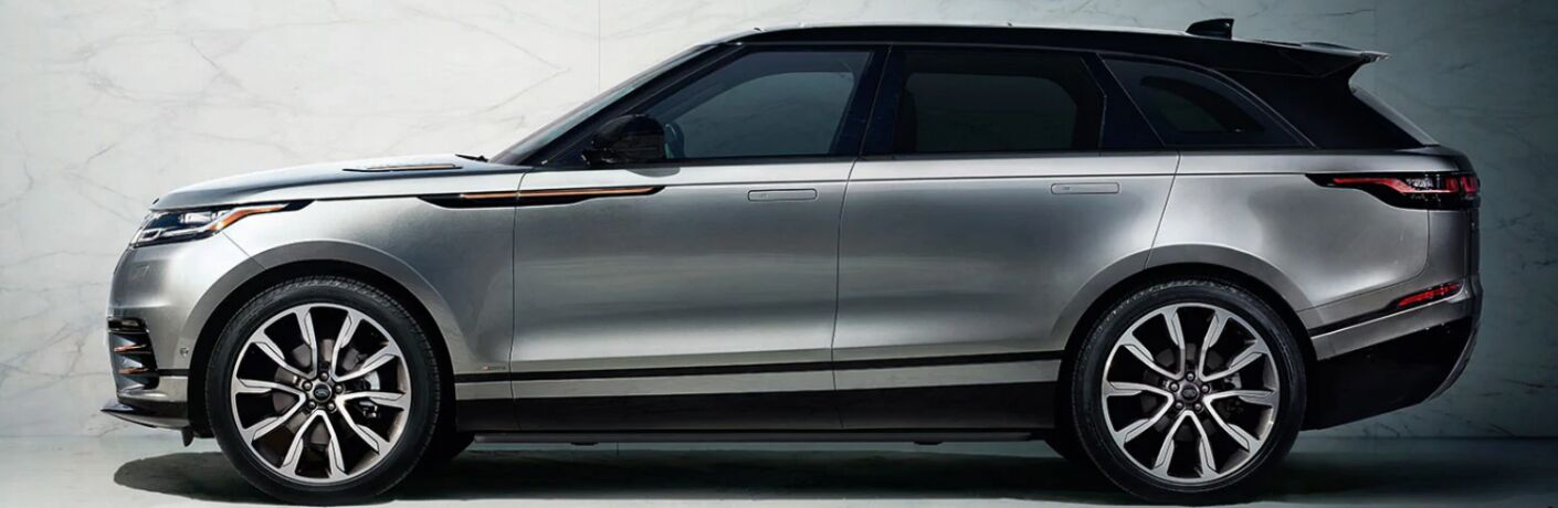 Side view of silver and black 2020 Land Rover Range Rover Velar