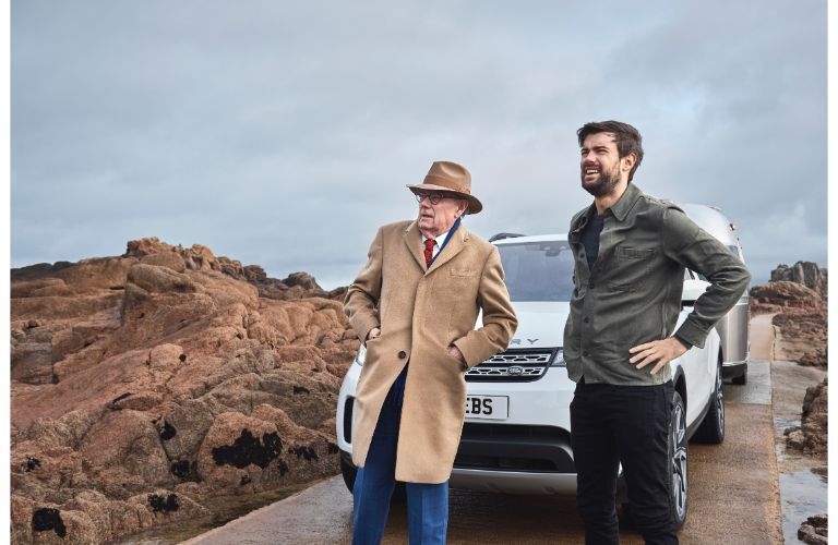 2020 Land Rover discovery front shot parked two men standing in foreground