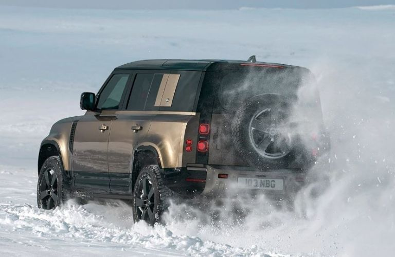 2021 Land Rover Defender driving on snow