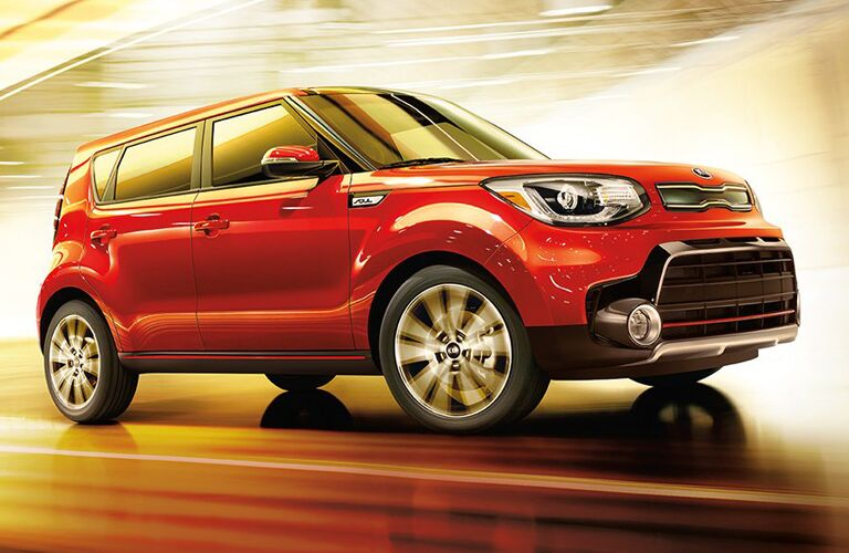2018 Kia Soul taking a curve with an orange glow