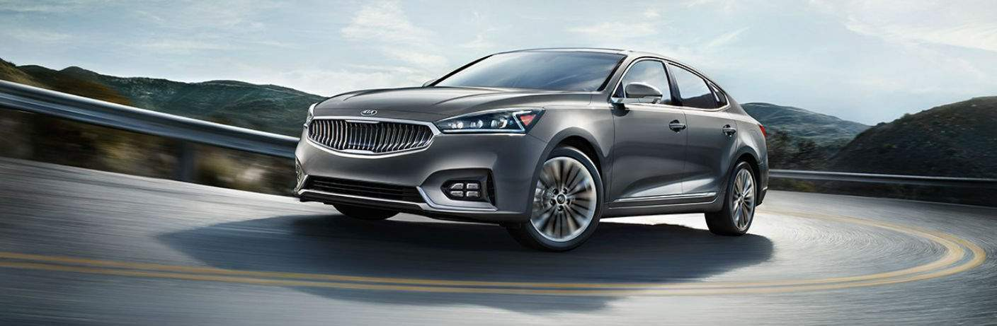 2018 Kia Cadenza driving on a curved road