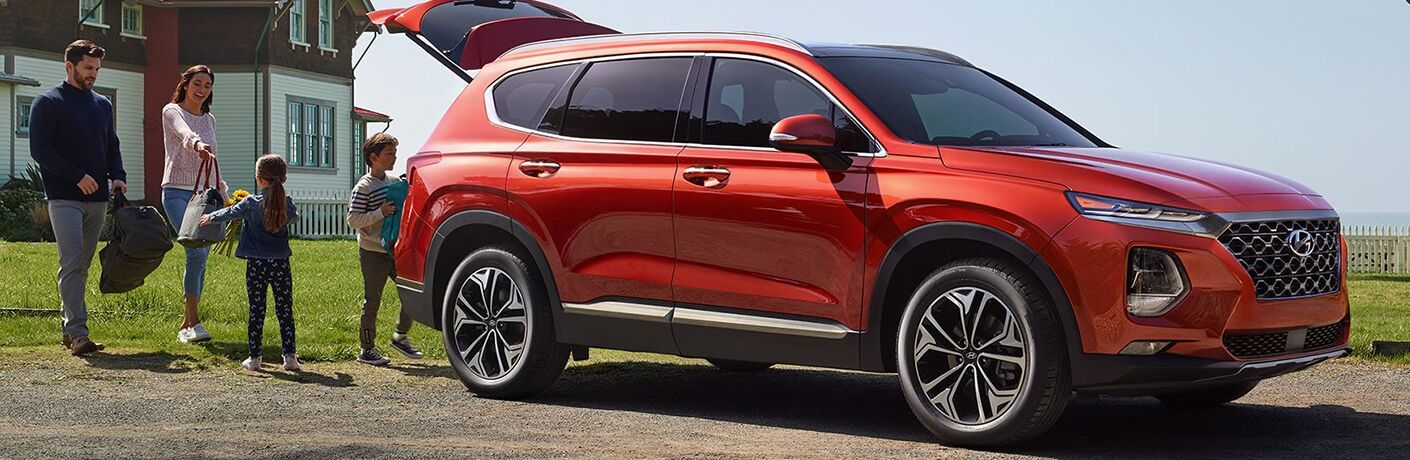 2019 Hyundai Santa Fe Exterior Passenger Side Front Profile Tailgate Open with Family