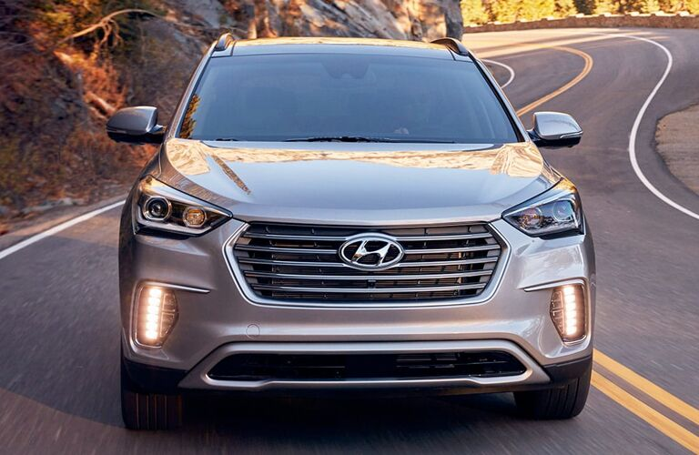 Front view of 2019 Hyundai Santa Fe driving on winding highway road