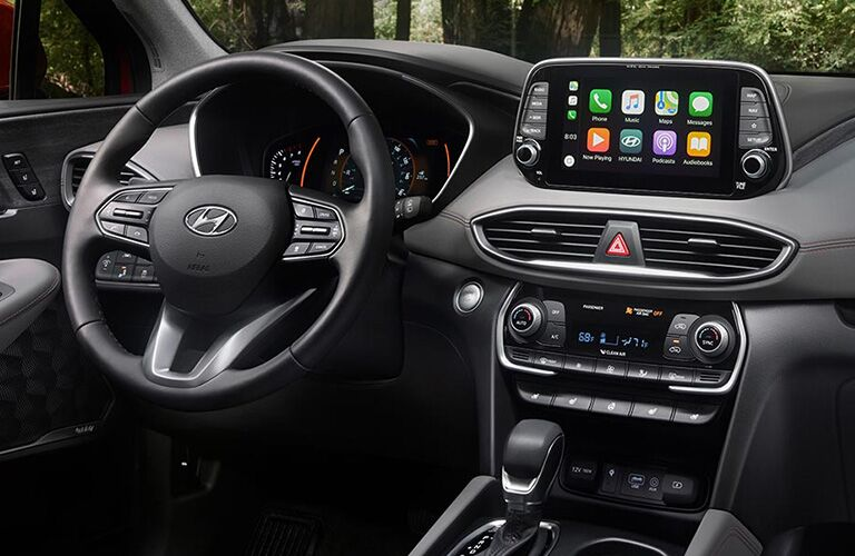 Interior Dashboard, Touchscreen and wheel inside the 2019 Hyundai Santa Fe
