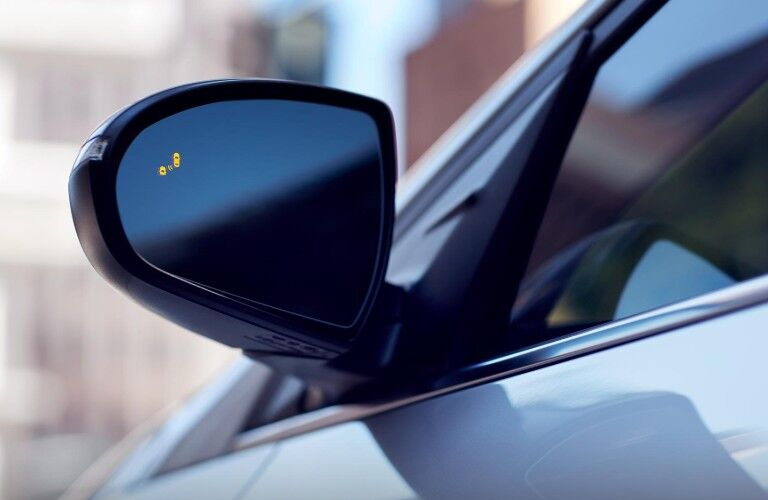 Close Up of the Driver side mirror of the 2019 Hyundai Ioniq with a blind spot light turned on