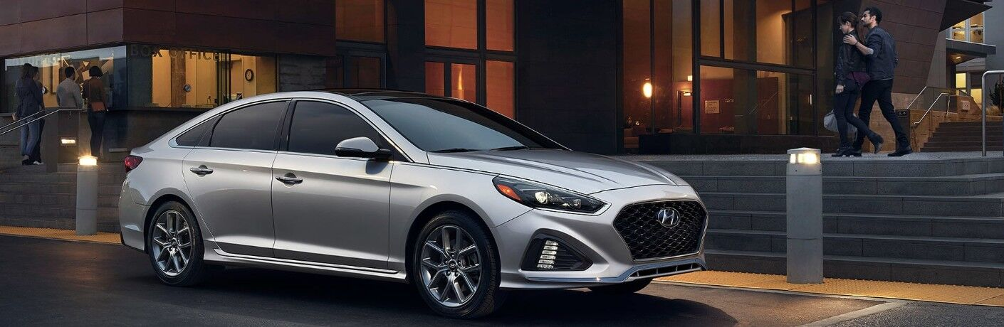 Silver 2019 Hyundai Sonata parked in front of modern-styled building