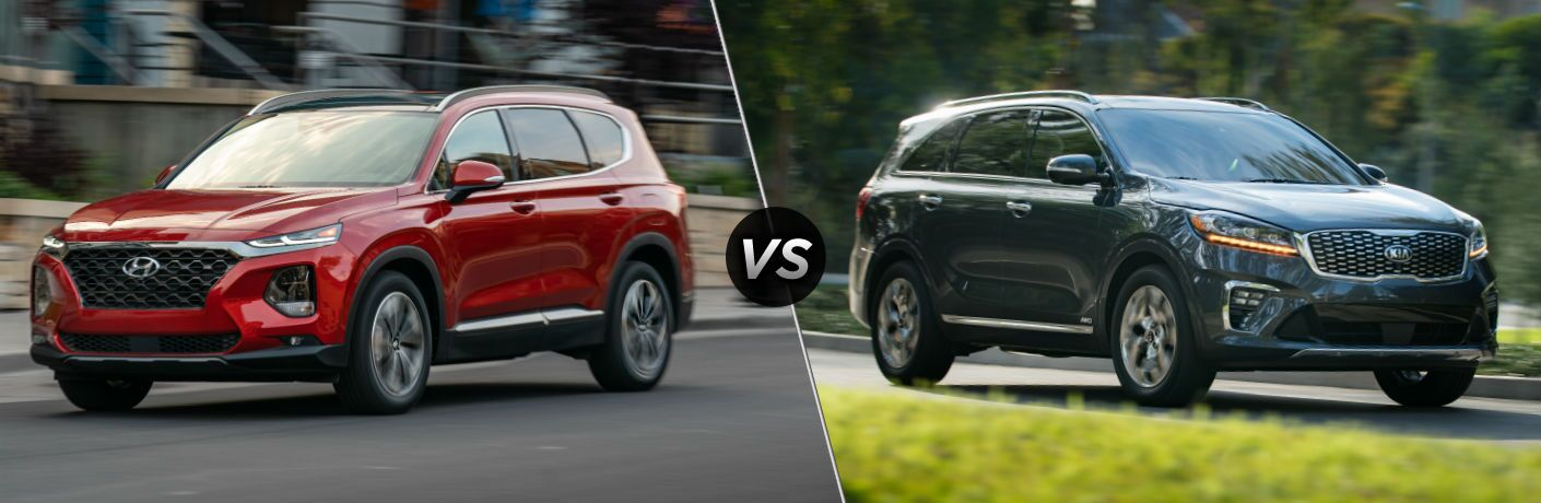 Red 2020 Hyundai Santa Fe on left and gray Kia Soreno on right
