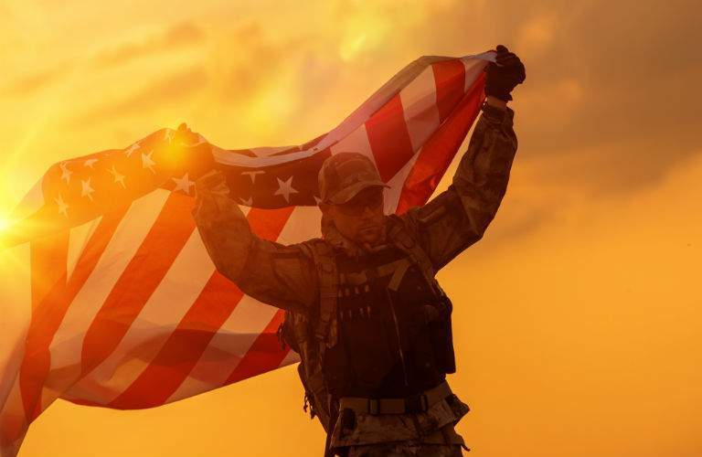 U.S. Military Personnel Holding American Flag