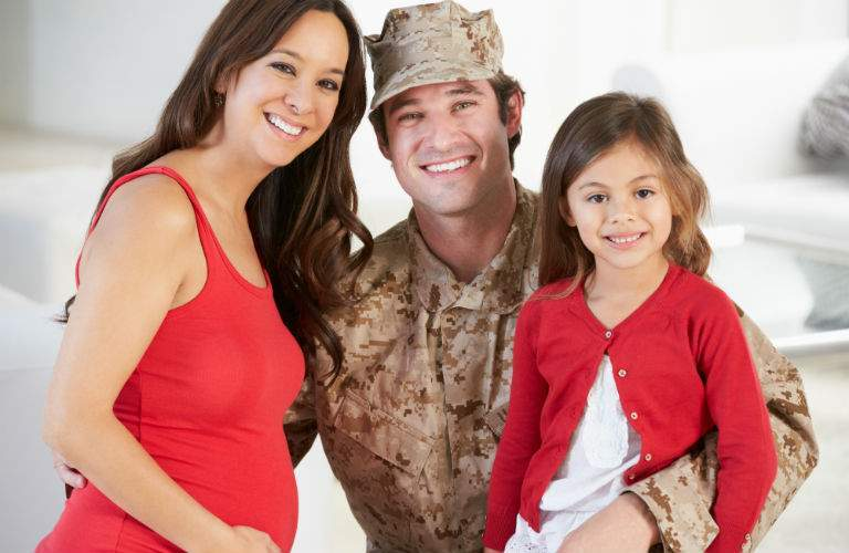 United States Military Soldier with Pregnant Wife and Daughter
