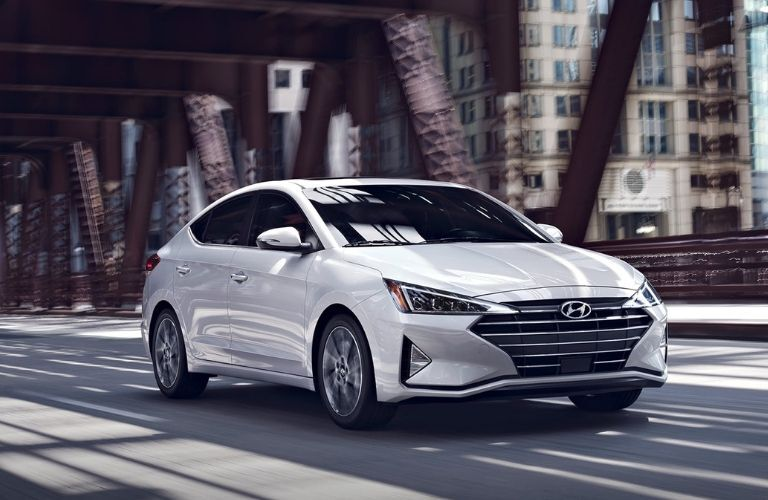 White 2020 Hyundai Elantra from front passenger side view on road