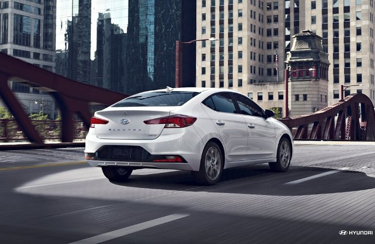 White 2020 Hyundai Elantra from rear passenger side crossing bridge
