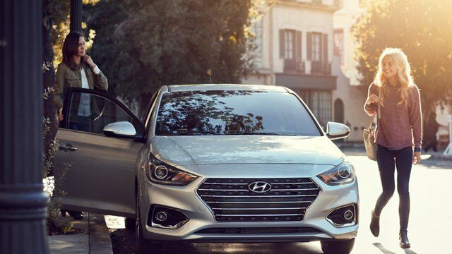 Women Getting Out of Parked Hyundai