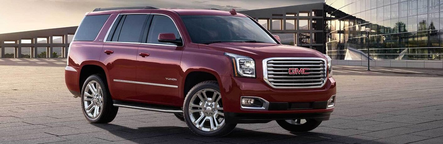 2017 GMC Yukon parked near a large facility