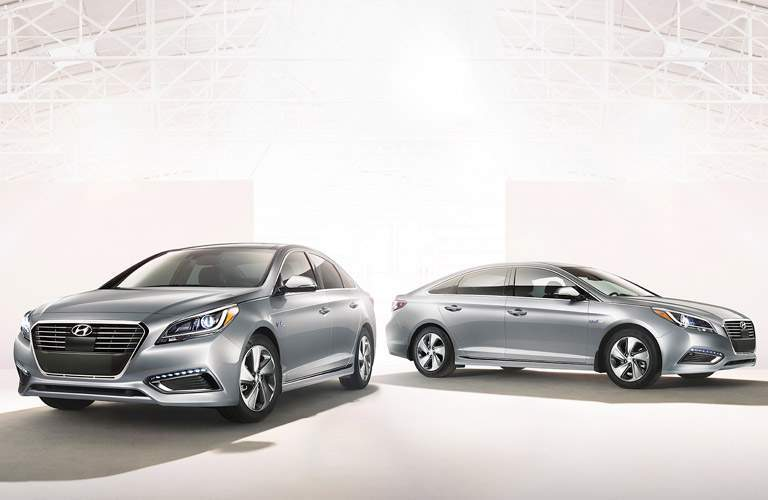 two silver 2018 Hyundai Sonata models parked against a white background