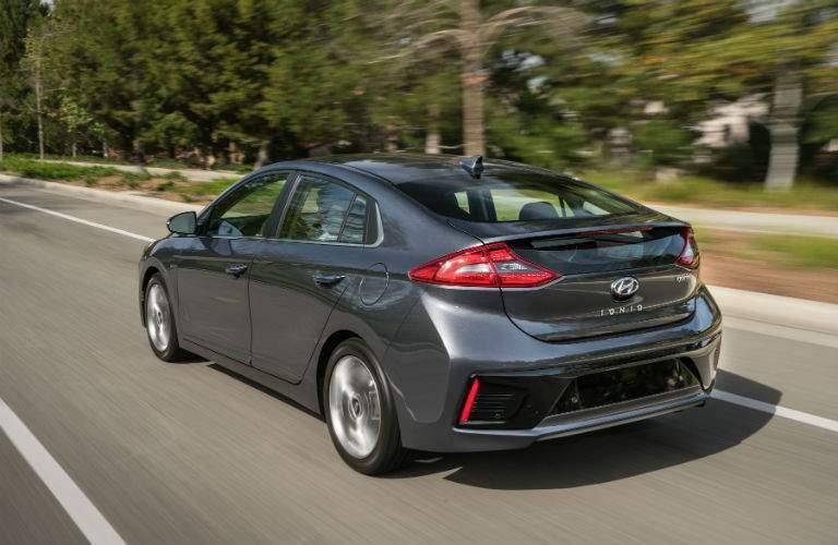 rear view of gray 2018 Hyundai Ioniq Hybrid driving along curve