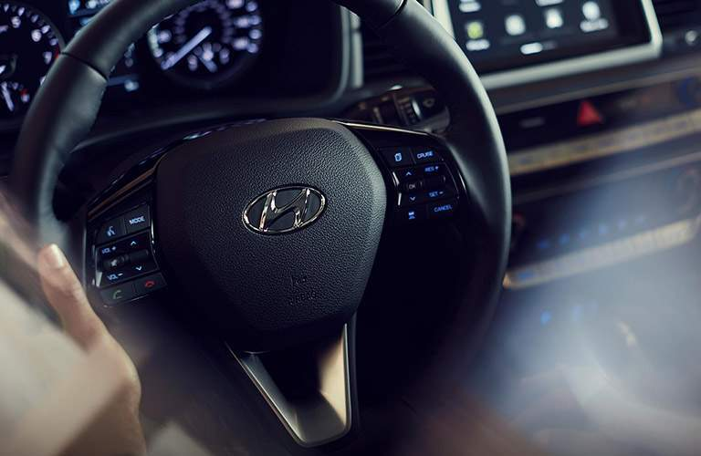 close up of the steering wheel of a 2018 Hyundai Sonata