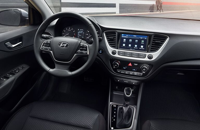 2019 Hyundai Accent interior shot of steering wheel, transmission, and dashboard layout with infotainment screen