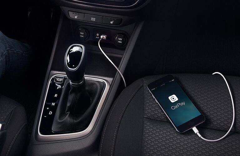 2019 Hyundai Accent interior shot closeup of smartphone plugged in with apple carplay activated