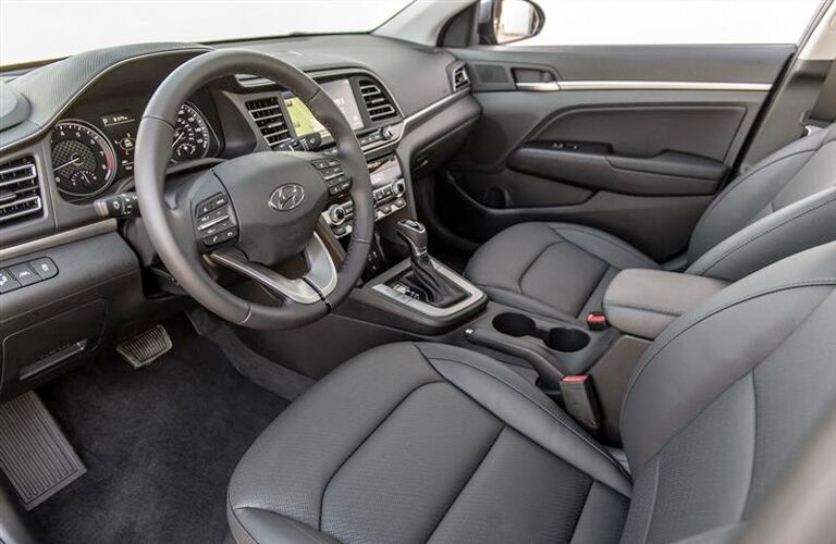 2019 Hyundai Elantra interior shot of front seating, steering wheel, and dashboard layout