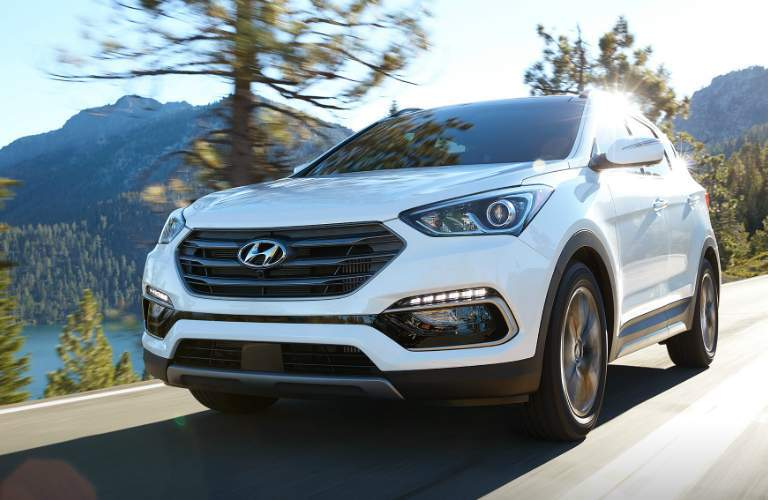 2018 santa fe sport in white driving on the road