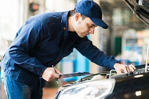 Mechanic Inspecting Certified Car